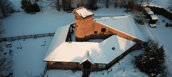 St Mark's Church, Kempshott. Photo from the air, church covered in snow.