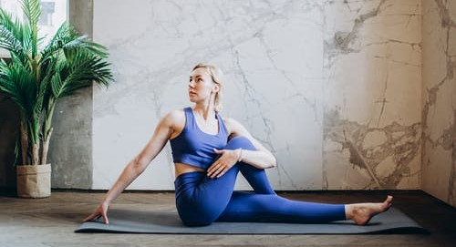 female holding seated yoga pose